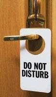 photo of a Do Not Disturb sign on a hotel room door