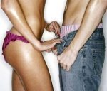 photo of a woman reaching into the pants of a man