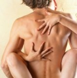 photo of the hands of woman on the back of a man