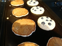 photo of blueberry pancakes cooking on the griddle