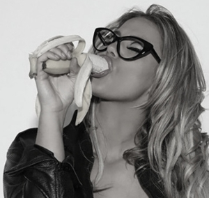 photo of a woman with a banana in her mouth