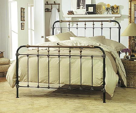 a photo of a brass bed