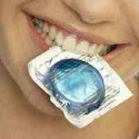 photo of a woman with a condom in her mouth