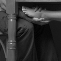 photo of a womans foot under the table on a mans fly