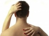 photo of a woman's hands on a man's bare back