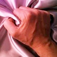 photo of the hand of a man clutching a 