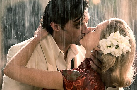 photo of couple kissing passionately in the rain