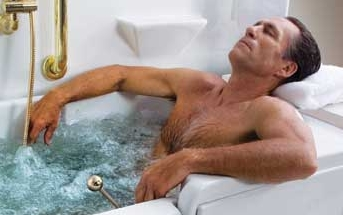 photo of a man relaxing in a bathtub