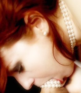 photo of a woman with pearls in her mouth