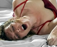 photo of a woman's face during orgasm