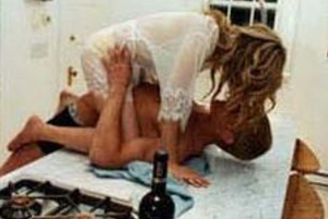 photo of man and woman having sex on the kitchen counter
