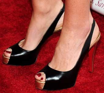 photo of sexy red tonails in beautiful open-toed high heeled shoes
