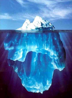 photo of an iceberg showing most of it is hidden
