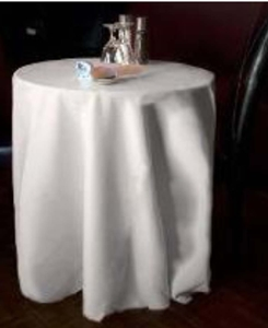 photo of a restaurant table with a long  tablecloth
