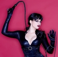 a photo of a woman in black leather  dominatrix gear