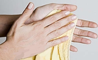 photo of a woman wiping her hands on a towel