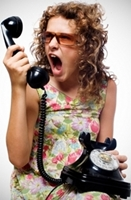 photo of a frustrated woman holding a telephone